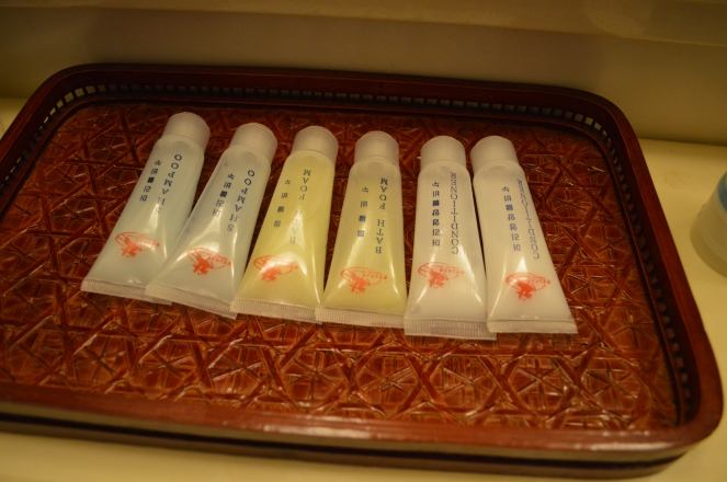 Hotel amenities. During housekeeping, they simply recluse the used tubes and placed them back so they appeared new,