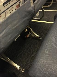 Legroom. Note the broken open IFE box below the seat.