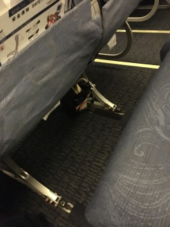Legroom. Note the broken open IFE box below the seat.