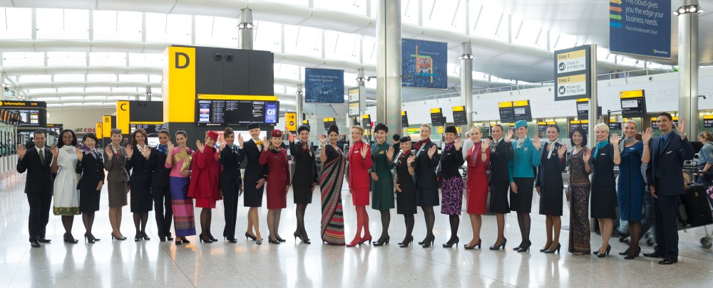 Uniformed staff wave as they pose in LHR T2 check-in (1)